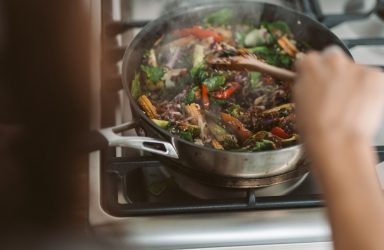 person-cooking-on-black-pan-4144234